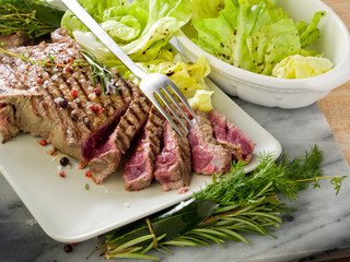 sliced steak with green salad