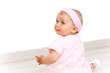 Portrait of cute baby girl with pink head band