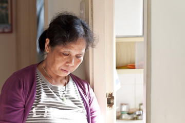 A 50s asian woman at home taking rest