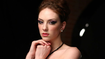 Model posing for photography in studio.
