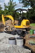 Mini Digger Installing Sand And Gravel Filter For Sewage