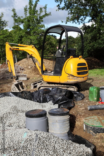 Mini Digger Installing Sand And Gravel Filter For Sewage - 38320122