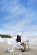 Businesswoman with working papers at beach