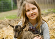 Gril with goatling