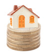 Toy house on stack of euro coins