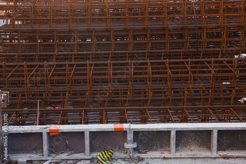 Steel rebars waiting to be used on a construction site.