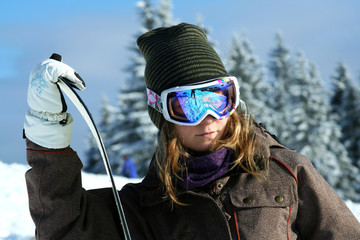 The girl snowboarder on the winter resort of