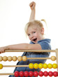 Cute child celebrates her traning success at an abacus
