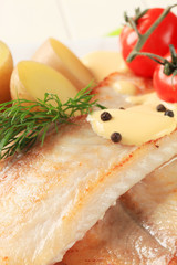 Pan fried fish fillets and potatoes
