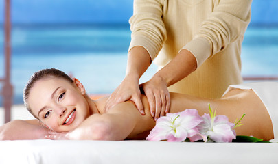 Smiling girl  getting spa massage