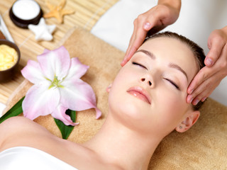 woman having spa massage of the head