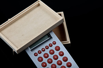 wooden box and calculator