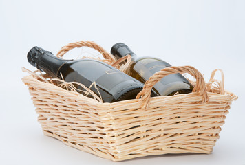 Wine Bottles In Basket.