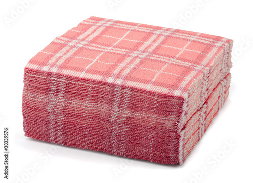 Stack of pink paper napkins isolated on white