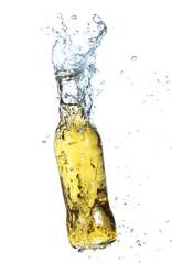 Bottle of cider with splash, isolated on white background