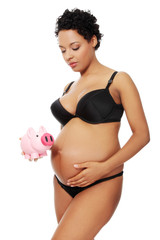 Pregnant woman dressed in black lingerie.
