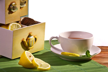 Cup of tea and Cupboard with lemon