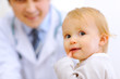 Portrait of baby and pediatrician doctor in background