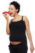 Pregnant woman eating healthy food.