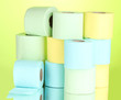 bright rolls of toilet paper on green background