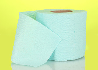 blue roll of toilet paper on yellow background