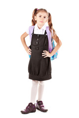 Portrait of beautiful little girl in school uniform