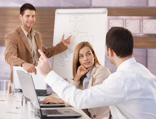 Happy businesspeople having training