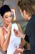 Beautiful woman receiving engagement ring