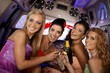 Pretty girls celebrating in limo