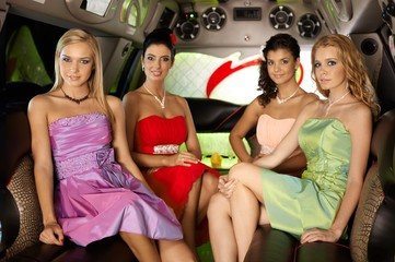Beautiful elegant women in limousine