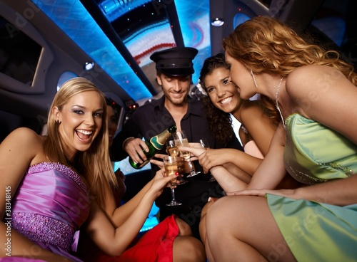 Happy girls having fun in limo