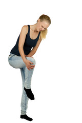 Young woman with knee injury on white background