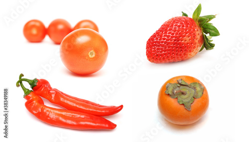 Collection of red fruit and vegetables isolated on white