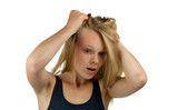 Young woman tearing her hair on white background