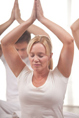 Group of people practising yoga