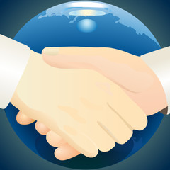 Handshake against dark blue globe background