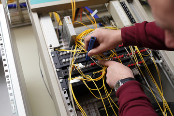 Technician cleaning fiber optic