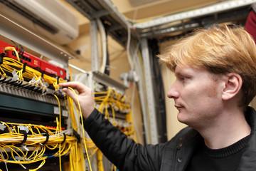 Technician connecting optical connector