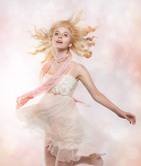 Adolescence - happy lovely young woman blonde in pink clothes