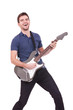 smiling man playing an electric guitar