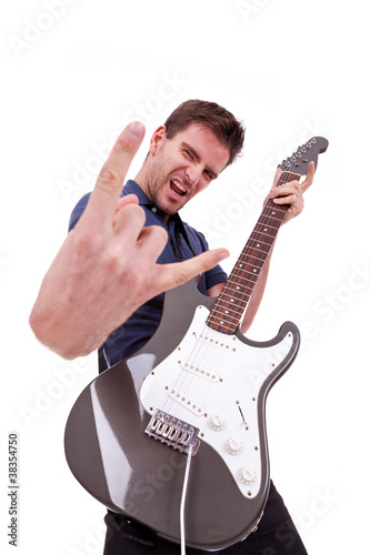 rockstar holding an electric guitar