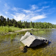 Stone in shallow water of Ladoga lake, Russia