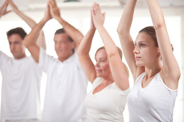 People practising yoga