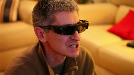 Expression Of Man Watching And Commenting A 3D Movie