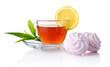 Cup of black tea with lemon, green leaves and marshmallow isolat