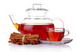 Glass teapot and cup of tea with spices isolated on white