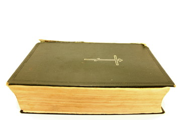 An old bible on a white background