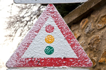 traffic sign for traffic light in snow