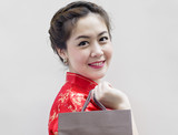 pretty woman in red Traditional Chinese Cheongsam with shopping