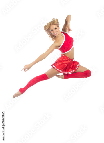 Happy female cheerleader dancer jumping